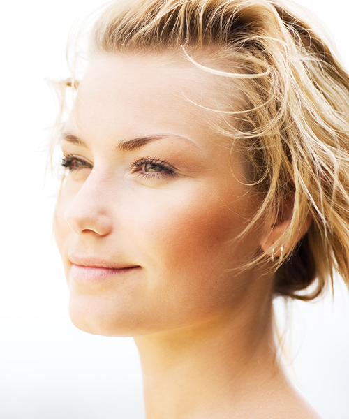 Woman showing her long neck and contoured jawline