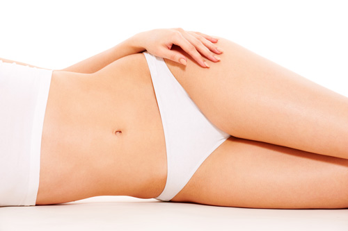 woman laying on her side showing her slip waistline
