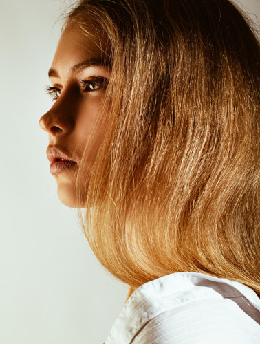 Woman looking into the distance showing contour of her nose