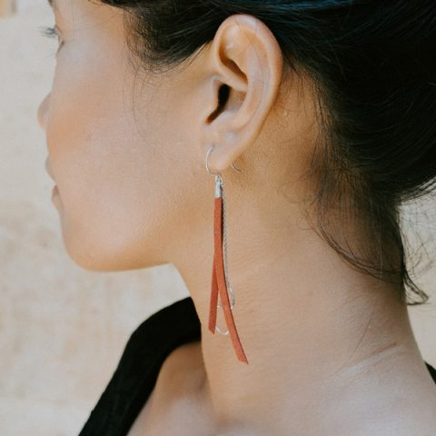 A woman turning away to show her neck and ear