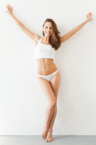 Woman smiling showing up a toned body